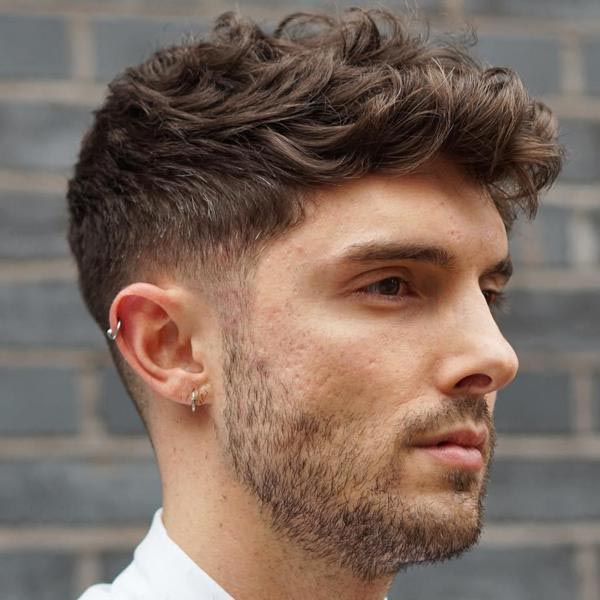 Dark Blonde Curly Taper Fade Haircuts for Guys